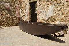 Typical boat of Passignano lake and nets royalty free stock image