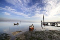 Typical boats anchored. In the muddy banks of the river with great sky - panoramic feel Royalty Free Stock Image