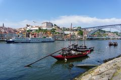 Typical boats of the Douro River in Oporto. Panoramic views of the historic city center of Porto in Portugal. Stock Images