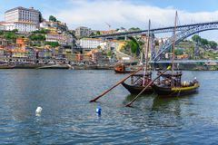 Typical boats of the Douro River in Oporto. Panoramic views of the historic city center of Porto in Portugal. Stock Photo