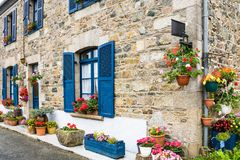 Typical Breton house in Brittany in summer. Travel in France - typical Breton house on Hent Sant Gonery street in Plougrescant town of the Cotes-d'Armor Stock Photos