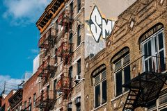 Typical brick buildings of Chinatown with sings in Lower Manhattan stock images