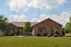 Typical brick ranch style home. Image of a typical style ranch home stock photo