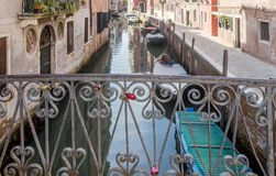 Typical bridge with love padlocks, Venice, Italy royalty free stock photography