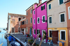 Typical brightly colored houses in Burano, Venice, Italy.  Stock Photos