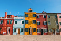 Typical brightly colored houses of Burano, Venice lagoon, Italy. Royalty Free Stock Photo