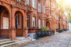 Typical, British Georgian houses in London. Kensington district, during autumn time with golden sunshine stock images