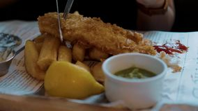 Typical British Pub Food - the famous Fish and Chips. Travel photography stock footage