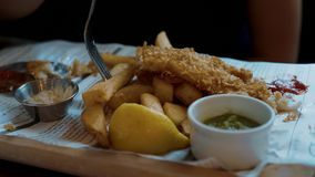 Typical British Pub Food - the famous Fish and Chips. Travel photography stock video footage