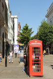 Typical British red telephone box in Covent Garden. The production of the traditional boxes ended in 1985, but there are still many standing in England Stock Photos