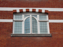 Typical British Window on a red brick wall.  Royalty Free Stock Images