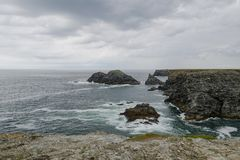 Typical brittany coastline with grey cloudy sky and immensity of atlantic ocean. Typical brittany rocky coastline with grey cloudy sky and immensity of atlantic royalty free stock images