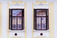 Typical building with antique wooden windows in Verona Stock Images