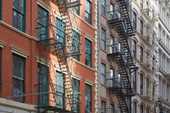 Typical building facades with fire escape stairs, New York Royalty Free Stock Photography