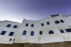 Typical building whit Moroccan windows, against a deep blue sky, Stock Photo