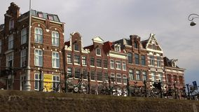 Typical buildings at the canal in the city of Amsterdam  City of Amsterdam. Typical buildings at the canal in the city of Amsterdam  Amsterdam Netherlands stock footage