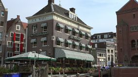 Typical buildings at the canal in the city of Amsterdam  City of Amsterdam. Typical buildings at the canal in the city of Amsterdam  Amsterdam Netherlands stock video