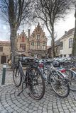 Typical buildings and cobbled square in Bruges royalty free stock images