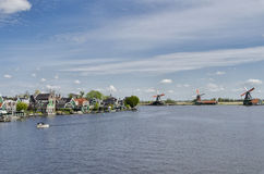 Typical buildings and windmills at Zaanse Schans, Amsterdam, Hol Stock Photography