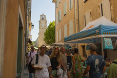 A typical busy outdoor street market in the Drome region of France on a hot summer day Stock Photo