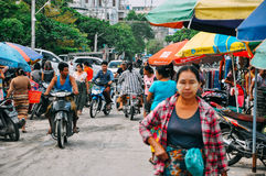 A typical busy street in Mandalay. Stock Images