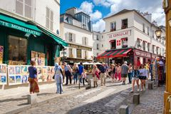 Typical cafes and art galleries in Montmartre, Paris. PARIS,FRANCE - AUGUST 4, 2017 : Typical cafes and art galleries in Montmartre Stock Images