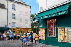 Typical cafes and art galleries in Montmartre, Paris. PARIS,FRANCE - AUGUST 4, 2017 : Typical cafes and art galleries in Montmartre Stock Image