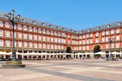 Typical cafes and restaurants at Plaza Mayor in Madrid. MADRID,SPAIN - AUGUST 5, 2017 : Typical cafes and restaurants at Plaza Mayor, a historic square in Madrid Royalty Free Stock Photography