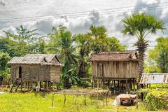 Typical houses in countryside in Cambodia. Typical Cambodian houses at the countryside road near Kampong Thom in Cambodia stock images