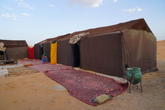 Typical camping in the ERG desert in Morocco. Erg Morocco A classic camp for tourists made up of clay and straw houses covered with traditional curtains .Desert Stock Image