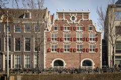 Typical canal house in Amsterdam Netherlands. March 2015. Landscape format stock image