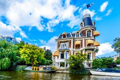 Typical Canal Scene with Historic Aristocratic Houses in Amsterdam under blue sky. Amsterdam, Noord Holland/the Netherlands - Sept. 28, 2018: Typical Canal Scene stock photo