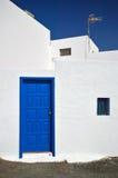 Typical canarian building Lanzarote. Spain. Typical canarian white building with blue door. Architecture, El Golfo village Lanzarote, Canary Islands stock photo