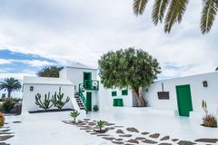 Typical Canarian house in Lanzarote, Canary Islands. Spain. white and green house stock images