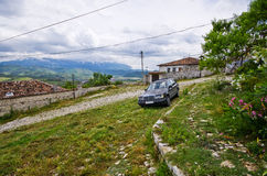 Typical car on old courtyard in Albania, Berat Stock Photography