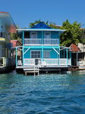 Typical Caribbean house over the water with dock Royalty Free Stock Image