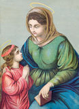 Typical catholic image of st. Ann with the little Mary from Slovakia. SEBECHLEBY, SLOVAKIA - JANUARY 3, 2015: Typical catholic image of st. Ann with the little royalty free stock photo