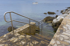 Typical cemented beach in Istria Royalty Free Stock Images