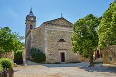Typical Central Square Of Southern France At Typical Scenic Medi. Eval Village of Monclus Gard Occitanie France stock images