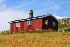 Typical chalet in mountins in Norway, Europe. Typical small chalet with red colour in mountains in Norway, Europe. In Jotunheim, near Bergen stock photo