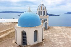 Typical chapels with blue domes in Fira Santorini Greece-2 stock photography