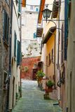 Typical characteristic narrow street in Montepulciano, a medieval and renaissance hill town near Siena, Tuscany, Italy Royalty Free Stock Photography