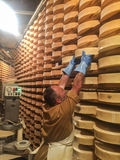 Typical Cheese Processing Fontina. Valpelline, Aosta, italy - April 24, 2017: Typical Cheese Processing Fontina at the old mine used for storage of cheese Stock Photography