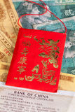 Typical China red envelope and different banknotes Stock Photos