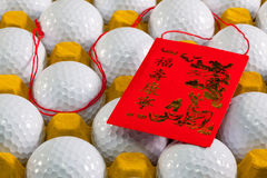 Typical China red envelope and golf balls Stock Image