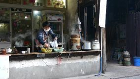 Typical chinese bun stand,a woman preparing breakfast,fresh buns with steam. Typical chinese bun stand,a woman preparing breakfast,fresh buns with lots of steam stock video