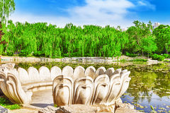 Typical Chinese garden,  park with bizarre rocks. Beijing. Stock Images