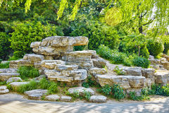 Typical Chinese garden,  park with bizarre rocks. Beijing. Stock Photos