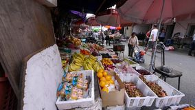 Typical Chinese old town street,shanghai shopping marketplace fruit Stand. stock video