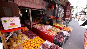 Typical Chinese old town street,shanghai shopping marketplace fruit Stand. stock video footage